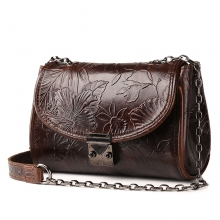 China factory cheap price embossed flowers pattern brown leather sling bag for women